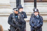 Tight security at Whitehall - Metropolitan Police officers, including Armed Police, in front of the Foreign and Commonwealth Building.