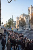 Whitehall, looking to the west, in the morning of Remembrance Sunday. Despite the early hour, and the security checks on both sides of Whitehall, a large crowd is building up.