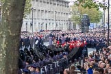 Remembrance Sunday at the Cenotaph in London 2014: Over 10,000 veterans waiting for the start of the March Past. Press stand opposite the Foreign Office building, Whitehall, London SW1, London, Greater London, United Kingdom, on 09 November 2014 at 11:31, image #1