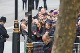 Remembrance Sunday at the Cenotaph in London 2014: Crowds waiting behind barriers at the eastern side of Whitehall.. Press stand opposite the Foreign Office building, Whitehall, London SW1, London, Greater London, United Kingdom, on 09 November 2014 at 08:13, image #4
