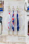 Remembrance Sunday at the Cenotaph 2015: The Cenotaph in the morning of Remembrance Sunday 2015. The tree flags represent the Royal Navy, the British Army, the Royal Air Force, and the Merchant Navy. Image #2, 08 November 2015 08:20 Whitehall, London, UK