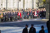 The first column of veterans is marching from Horse Guards Parade onto Whitehall before the Remembrance Sunday Cenotaph Ceremony 2018 at Horse Guards Parade, Westminster, London, 11 November 2018, 10:08.