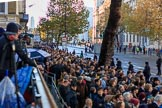 Crowds of spectators are building on on Whitehall before the  Remembrance Sunday Cenotaph Ceremony 2018 at Horse Guards Parade, Westminster, London, 11 November 2018, 08:38.